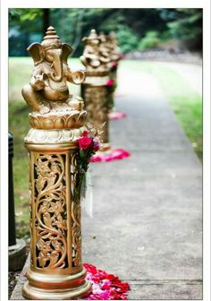 Beautiful Ganesha decorated pillars for wedding entrance