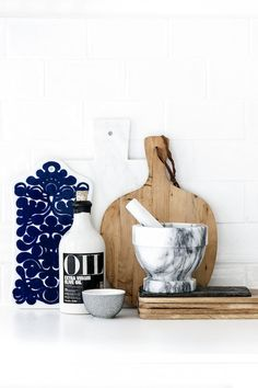 Marble mortar and pestle and a vintage chopping board in a Helsinki home