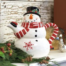 Snowman Teapot  Snowman Teapot  He's a little teapot, short and stout; his scarf is the handle, his arm is the spout. And his head is the lid! Ceramic; holds about 16 oz. Hand wash only. A fun holiday gift for tea-loving friends! $12.99