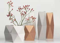 Cardboard Snug Vases - come as a flat-pack, ready to be folded into shape and placed over a glass or bottle of water.