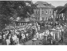 Amalgamation meeting, Lagos 1914.  On the first of January 1914, the Northern and Southern Protectorates were merged together as one and Nigeria as we have it today was born. 2nd photo shows celebrations of the amalgamation along Tinubu street, Lagos.