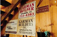 Old Garman Builders signs hang in a Lancaster County Barn. www.garmanbuilders.com. Photography by Eric Forberger for http://www.lancastercountymag.com