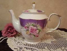 purple, teapot with lace and pearls.  all my loves  together