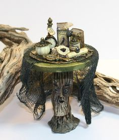 1:12 scale witch beauty products by Manela Herbst. Fairy table done by Karin Caspar.