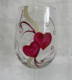 Wine glass hand painted with red hearts