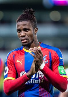 Wilfried Zaha of Crystal Palace during the Premier League match between Crystal Palace and Burnley FC at Selhurst Park on December 2018 in London, United Kingdom. Get premium, high resolution news photos at Getty Images Premier League News, Premier League Matches, Burnley Fc, Crystal Palace Fc, Fc Bayern Munich, Football Wallpaper, Manchester United, Captain America, Red And Blue