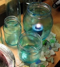 Day 25 DIY Blue Glass Jars.  Mod Podge and food color on recycled jars.http://diannefaw.files.wordpress.com/2012/06/img_0218.jpg