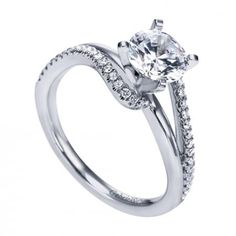 So cool! Love the bypass style on this engagement ring from Wedding Day Diamonds