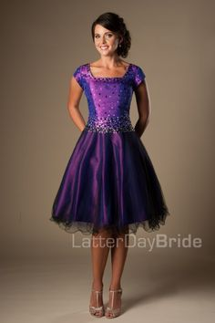 The Zoey | This darling modest prom dress features a lovely princess-cut bodice sparkling with two-tone beading, with a full A-line skirt layered with black tulle.    Dress available in Purple, Mint or Silver    Dress shown in Purple    Dress Available at LatterDayBride.com or in Store Located in Salt Lake City, Utah