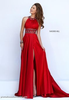 Red prom dress with collared neckline and beaded belt. Red, Sherri Hill prom dress. Long red dress.