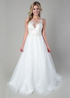 {Rachel Leah} Royal and exquisite, this ball gown wedding dress features an illusion neckline and back with hand appliquéd organza and beaded flowers, full tulle skirt, and a sweep train. We would love to see this at a romantic holiday wedding!