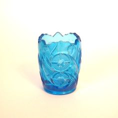 Here is a beautiful Early American Pressed Glass toothpick holder in a beautiful blue made by Jefferson Glass called, Double Circle, No. 231. Circa