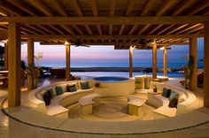 A conversation pit is an architectural features that incorporates built-in seating into a depressed section of flooring within a larger room Sunken Living Room, Outdoor Living Rooms, Outdoor Spaces, Outdoor Seating, Romantic Hotel Rooms, Conversation Pit, Wood Patio Furniture, Villa, Built In Seating