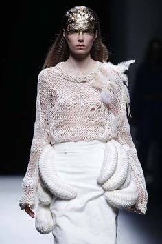 Wearable Art - tailored white skirt juxtaposed with bold sculptural shapes - 3D fashion details; knitwear design // Manuel Bolaño
