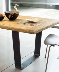 GATE | What distinguishes the Gate table is the particular shape of its natural waxed metal trapezium legs that support the solid antique elm top. A modern furnishing solution with an unmistakable design.  #madeinitaly #design #artigiani #interiordesign #artisans #italian #interiordetails #homedesign #homestlye #wood #artists #interiordecor