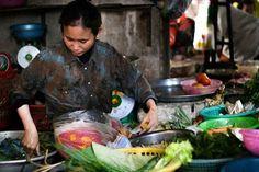Woman preparing vegetables, Phnom Penh central Market (Cambodia)
