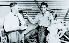 A 21-year-old Elvis Presley with actress Debra Paget and reporter Jules Archer on the set of the 1956 film Love Me Tender.