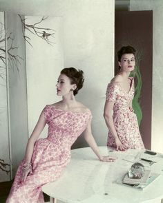 Tom's Grandma!!! <3 January 1954 Two models, Mary Jane on the left and Leonie Vernet on the right are both wearing dresses of silk surah in shades of pink. One printed with organic shapes, the skirt back-swung. The other in impressionistic pink flowers. The flowers on the bodice are embroidered with beads. Image by © Condé Nast Archive/Corbis