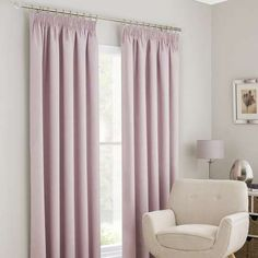 Designed with blackout lining to reduce unwanted external light from entering, these pink curtains feature a pencil pleat header and are available in a choice o...