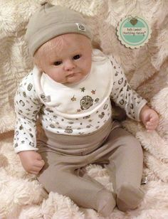 "LOUIS is a custom order baby that I created from Marissa May's ""Eden"" sculpt. He was born April 14, 2013, is 23"" long, weighs 7 lbs. 3 oz. and lives in NEBRASKA, USA. See him at www.heartstringsnursery.com."