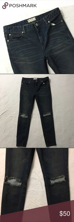 Free People Ripped Knee High Waisted Skinny Jeans Dark was high waisted skinny jeans by Free People. Intentional knee holes. Intention distressing and wickering within the denim. Great condition. No other flaws or stains. Waist: 15.5 inches. Rise: 9 inches. Inseam: 27 inches. 53% cotton, 23% rayon, 22% polyester, 2% spandex. ❌No trades❌ Free People Jeans Skinny