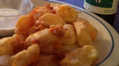 Real Wisconsin Fried Cheese Curds  -  crispy, gooey, savory snack.  good reviews, want!     lj