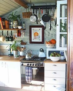 Small kitchen. I love the look of everything hanging... for our studio apartment