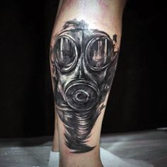 Leg Calf Black Gas Mask Tattoo Design For Males