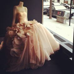 Poofy dress + petals ! Reminds me of the dress Ashley designed for prom in high school. So pretty.