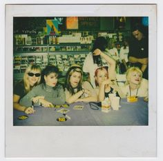 Polaroid of L7 Official -with Courtney Love showing support- during an L7 record signing at Tower Records benefiting AIDS relief, 1993. — with Suzi Gardner, Dee Plakas, Donita Sparks, Donita Sparks, Jennifer Precious Finch and Courtney Love at San Fernando Valley CA.