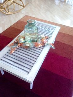 Shutter table with glass top, add wooden legs to repurposed shutter.  Upcycle, recycle, salvage, repurpose, diy!  For ideas and goods shop at Estate ReSale  ReDesign, Bonita Springs, FL