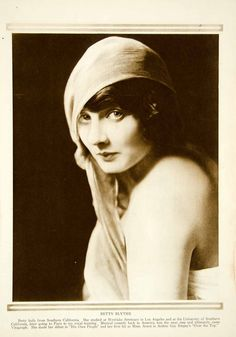 This is an original 1919 sepia rotogravure of Betty Blythe, a silent film actress best known for her role in The Queen of Sheba. She was also one of the first movie stars to ever appear partially-nude