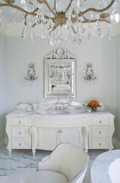 Elegant and ultra-feminine bathroom. Love the use of white marble on the floors, bath and courtertop; also love the mirror, lighting, cabinets. Perfectly white!