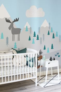Cute, comfortable and contemporary. This nursery space ticks all the boxes, working calming neutrals with lively pops of blue and pastel mint. The illustrative mountain brings joy and character to your walls.