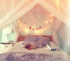 Idea: Could somehow pin voile sheets on wall behind Holly's bed in the smaller section of the room with the fairy lights too but no posters on bed. I like a lot!