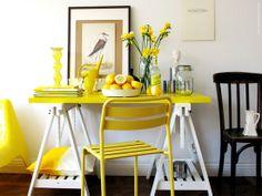 I love the bright yellow of this desk vignette. #decor