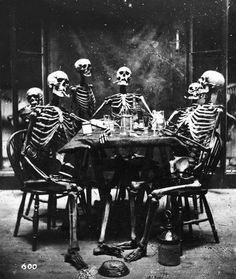 Six skeletons smoking around the dinner table, circa 1865. (Photo by London Stereoscopic Company/Hulton Archive/Getty Images)