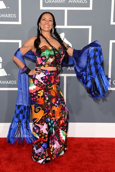 """Alfombra roja de los Grammy 2013. Lila Downs at the Grammy Awards. Check out her newest album, """"Pecados y Milagros"""" (Sins and Miracles). It was inspired by the themes of traditional votive paintings of Mexico, as well as her infant son. The new songs were born of the reasons to find items and symbols that give us strength."""