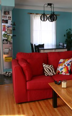 Turquoise accent wall with new red couch