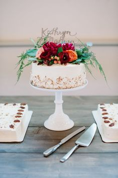 "Small cake with sheet cakes to feed the masses.  Means you can cut cake for guest before/during the actual ""cake cutting"" and have it ready to serve!"