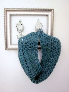 the scarf is cute, but I like the idea of putting a neat frame on the wall with coat hangers. cute decor idea