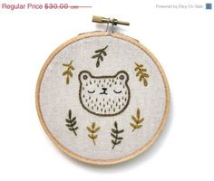 Sleepy bear  hand embroidered wall hanging by sleepyking at Etsy! Go check it out. SO CUTE!