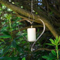 Hanging Heart in Distressed Metal. A stylish way to attract birds to your garden; this hanging heart bird feeder is made from aged metal giving it a worn quality that suits any garden. It can also be used as a candle holder to create subtle lighting in the evenings. #gardendecor #hearts