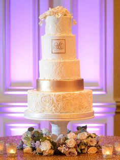 Substitute a traditional wedding cake topper with an elegant sugar flower topper for an all-natural cake.