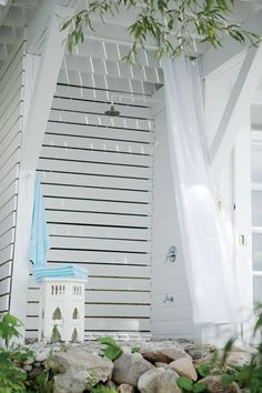 Awesome outdoor shower!  Charming Boathouses | House & Home