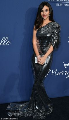 Eye-catching: Victoria Justice had all eyes on her in her lustrous silver dress. Vicky Justice, White Tux, Silver Sequin Dress, Blue Tuxedos, Androgynous Look, Victoria Justice, Ruched Dress, Heidi Klum, Red Carpet Fashion