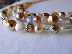'Handmade Golden Pearl Necklace' is going up for auction at 12pm Fri, May 10 with a starting bid of $7.