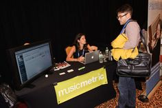 Music Metric speaking with attendees. #NMS2013