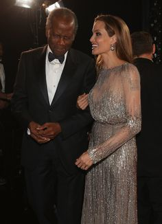 Absolutely gorgeous! Angelina Jolie spoke with Sidney Poitier backstage at the Oscars.