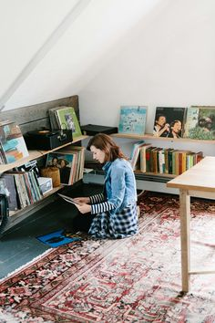 madewell jean jacket in ellery wash, stripe anthem long-sleeve v-neck tee, oversized boyshirt in andover plaid worn by travel writer christina pérez as she sorts through vinyl records in the attic of table on ten, an inn in bloomville, new york. #everydaymadewell